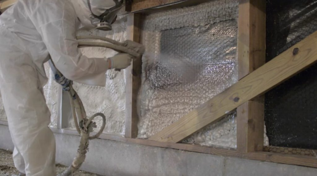 Man Installing agricultural spray foam insulation