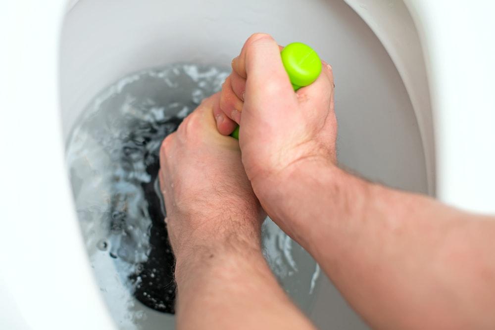Plumber Using Plumber In Toilet
