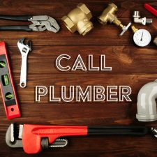 Call San Antonio Plumber. Plumber tools frame on wooden background